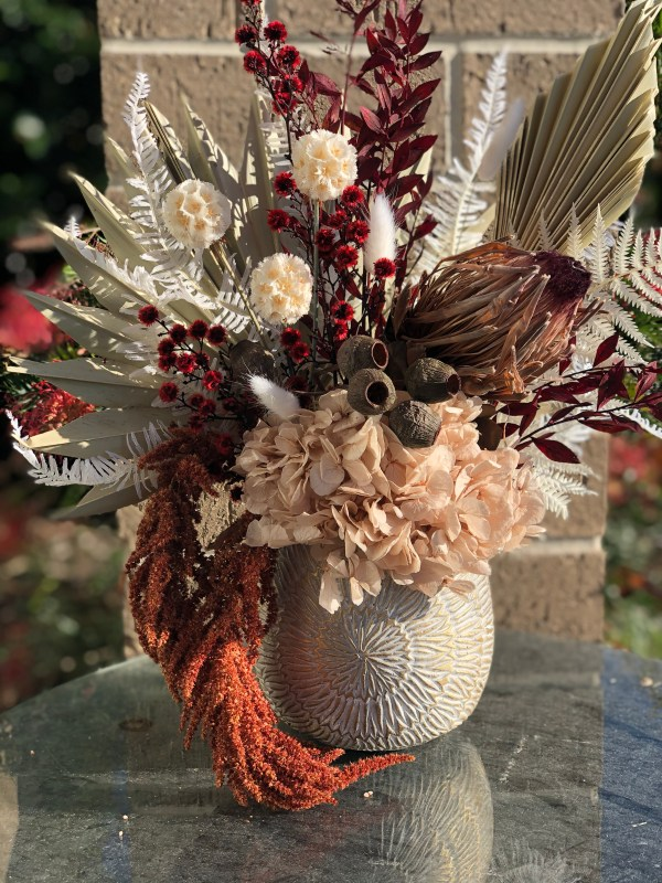 Featuring King Protea, Gum nuts, ruscus, amaranthus, scabiosa pods, preserved hydrangea, bunny tails and riceflower.