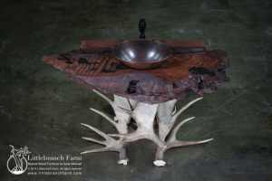 Rustic vanity with curly redwood and moose antler base