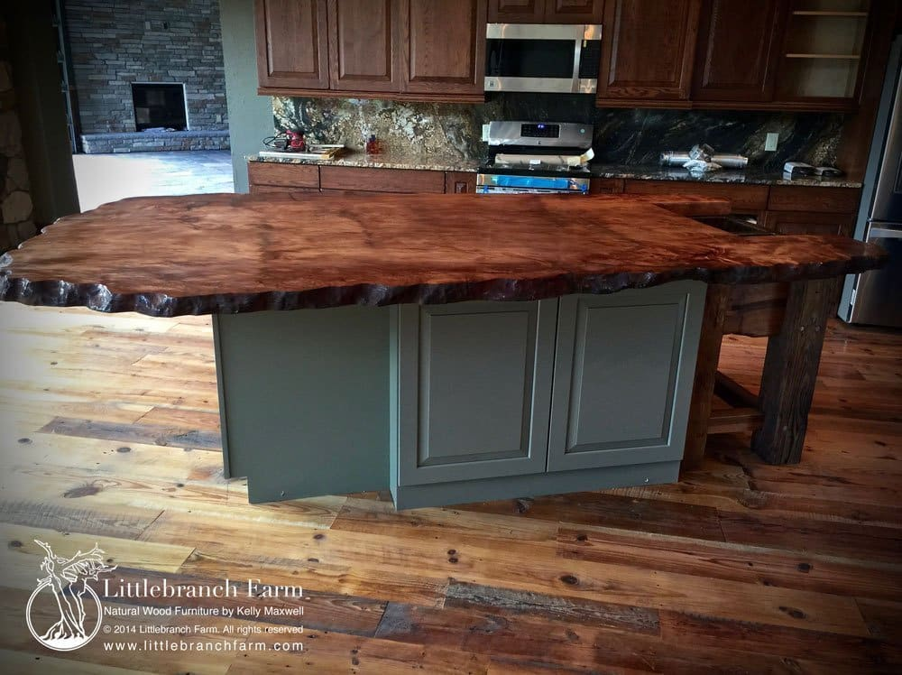 Slab wood countertop in rustic kitchen