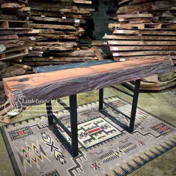 Garish live edge wood on southwest gray rug.