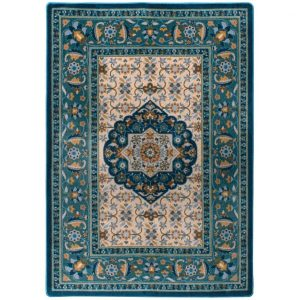 Beautiful floral designs on teal rug