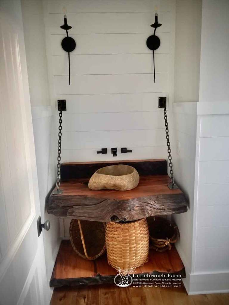 Natural wood bathroom decor with floating vanity and white shiplap walls.