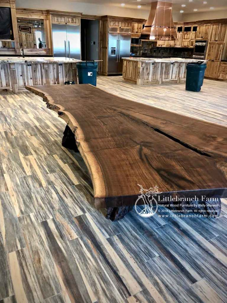 Black walnut live edge dining table on wood floors