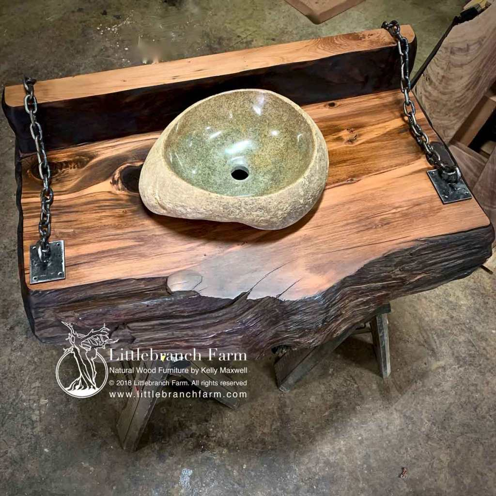 Stone sink on redwood slab.