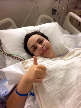 In the recovery room and already giving the thumbs up. That's because the anesthesia was still working.
