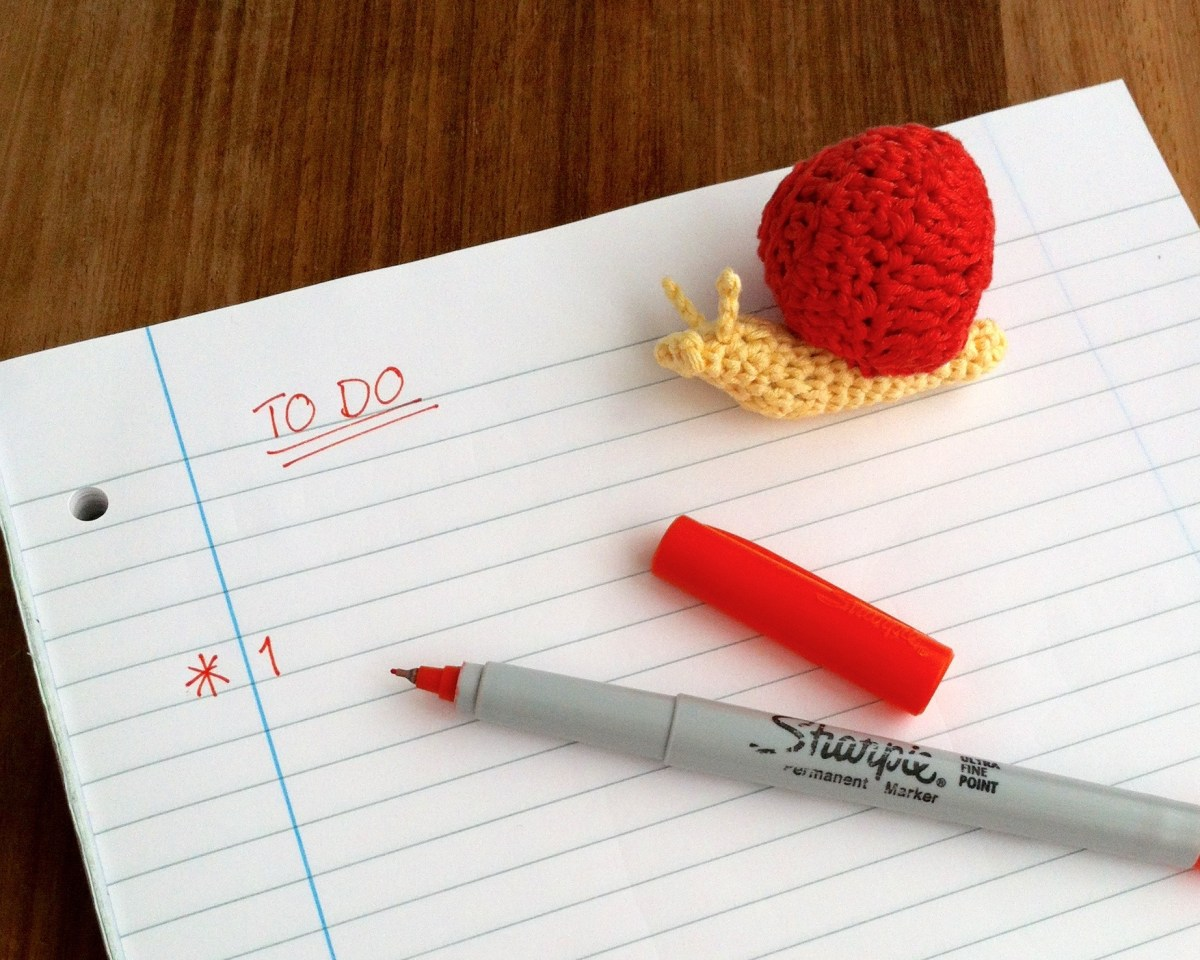 Picture of a Little Conkers Mindful Snail next to a To Do List