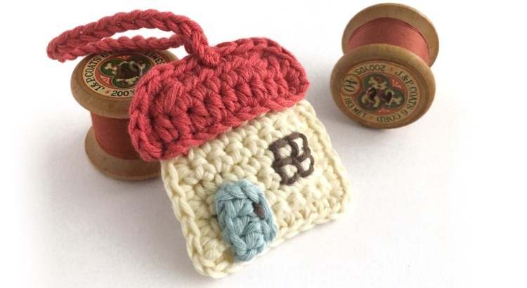 Tiny crocheted key ring in shape of cottage