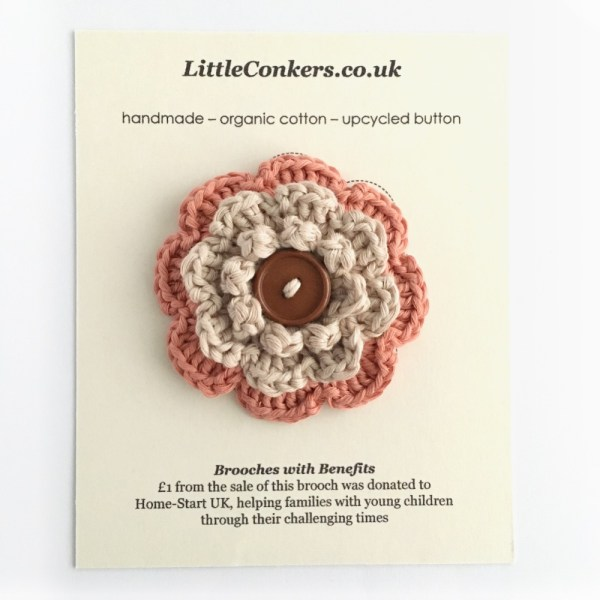Hand-crocheted coral and stone brooch in organic cotton with upcycled button