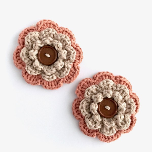 Eco-friendly flower brooches with buttons from the Little Conkers Brooches with Benefits range