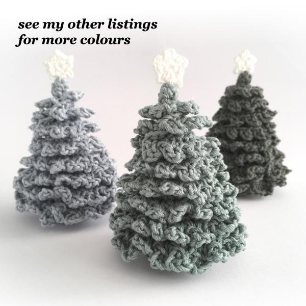 Miniature crocheted Christmas trees in a range of colours