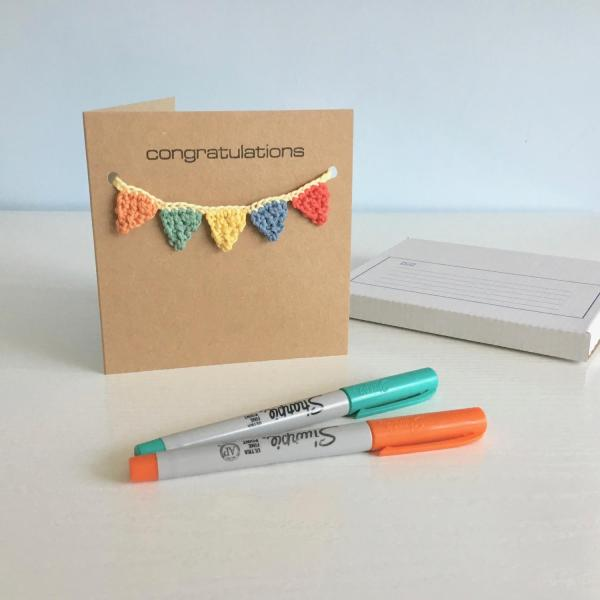 Recycled kraft greetings card with colourful crocheted bunting