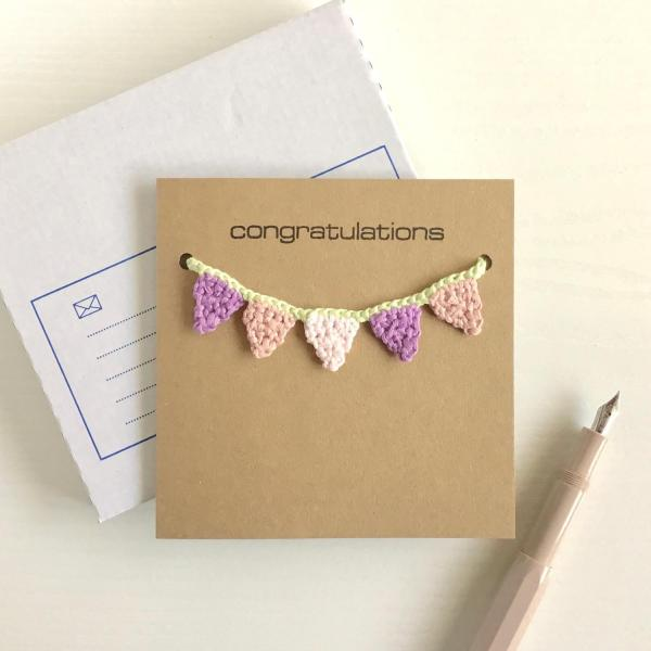 Recycled kraft greetings card with pink and purple crocheted bunting