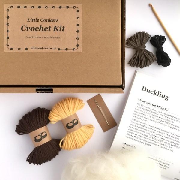 Box containing yarn, crochet pattern and crochet hooks