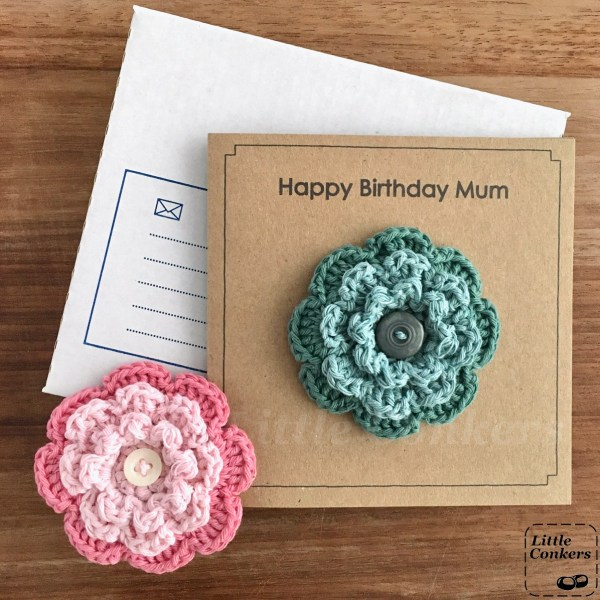 Recycled birthday card with a crocheted flower brooch.