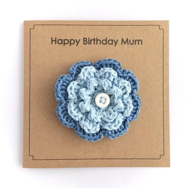 Kraft birthday card with blue crocheted flower brooch