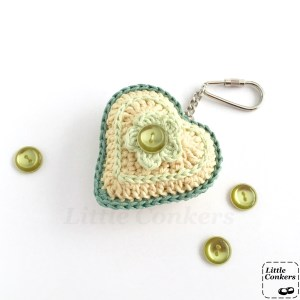 Green and yellow crocheted heart keyring with button