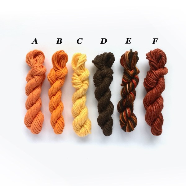 Mini yarn skeins in orange and brown
