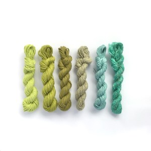 Set of mini yarn skeins is shades of green