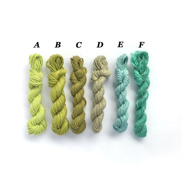 Miniature yarn skeins in shades of green