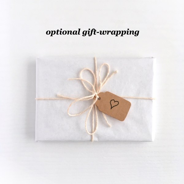 Small parcel gift-wrapped in recycled tissue and string