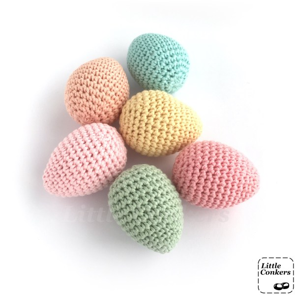 Crocheted eggs in pastel colours