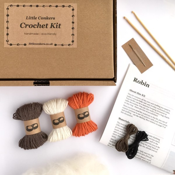 Box containing yarn, crochet hook and crochet pattern for a robin