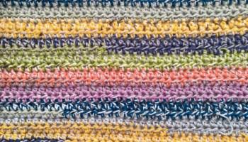 Blanket crocheted with scrap yarn