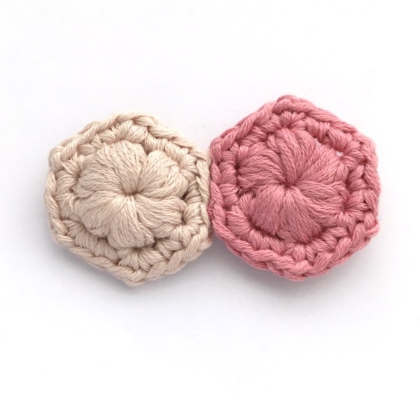 Crocheted brooch made of two hexagons in pink and beige