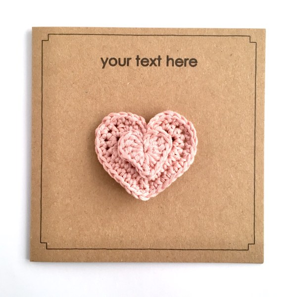Recycled greetings card with pink crocheted heart brooch and your choice of text.
