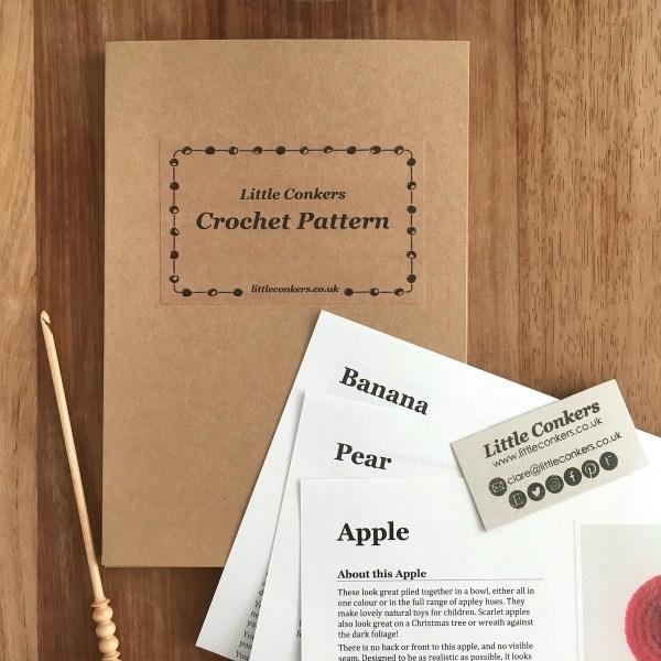Printed crochet patterns for fruit in a kraft folder