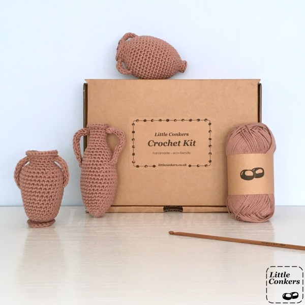 Kraft brown box with crocheted amphorae and yarn