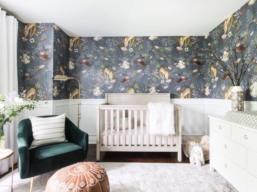 Gender neutral nursery with animal wallpaper
