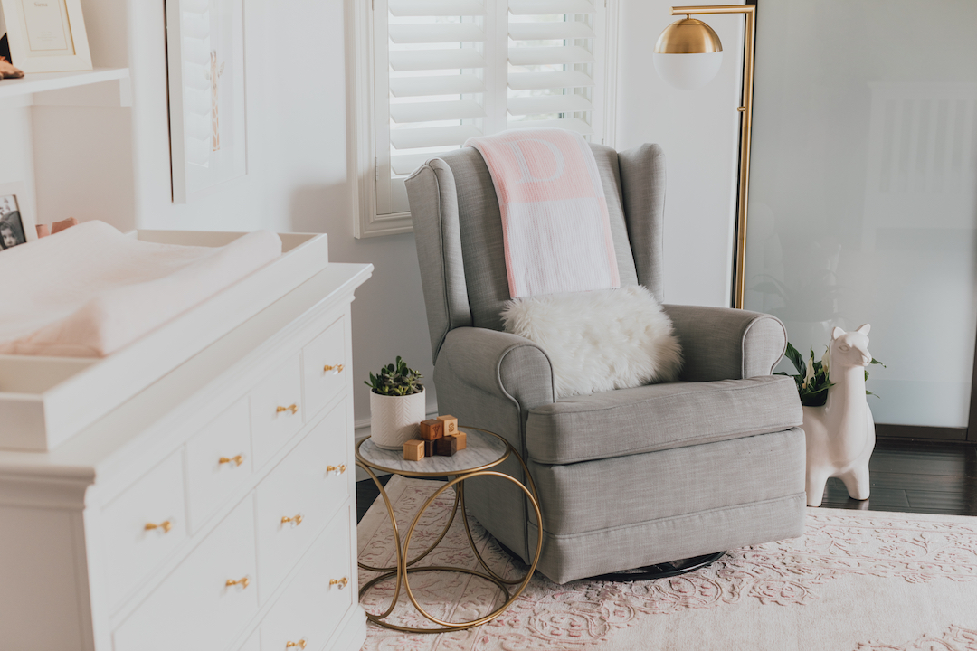 Pink Nursery with Gray Glider by Little Crown Interiors