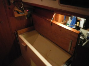 The workbench raised to reveal the large storage area.  Lots of room but awkward.