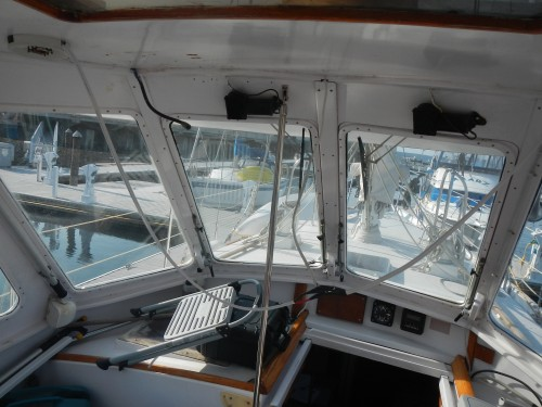 A view of the cables hanging down inside the dodger. I re-used the holes drilled for the old panels.