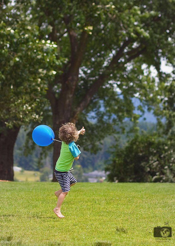 boy outside with a balloon
