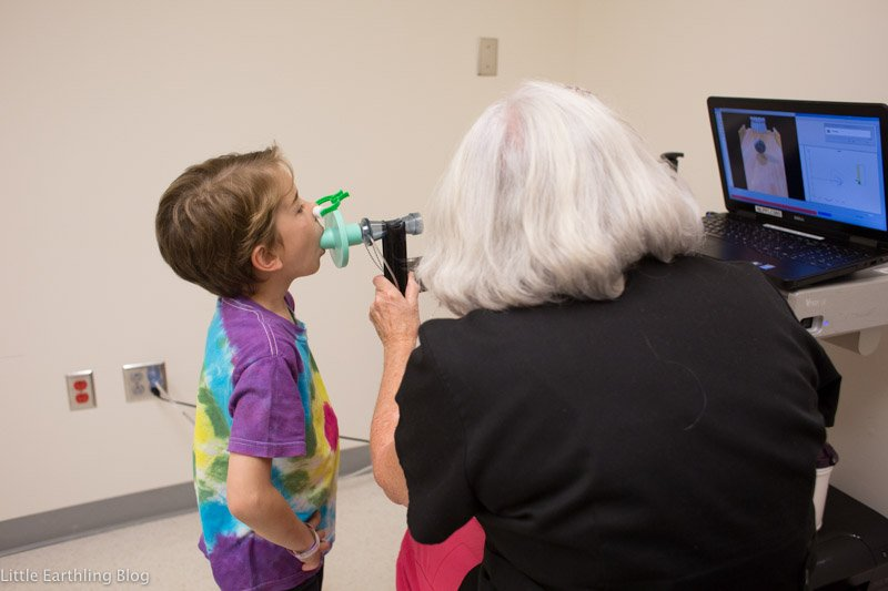 Six-year-old having a pulmonary lung function test.