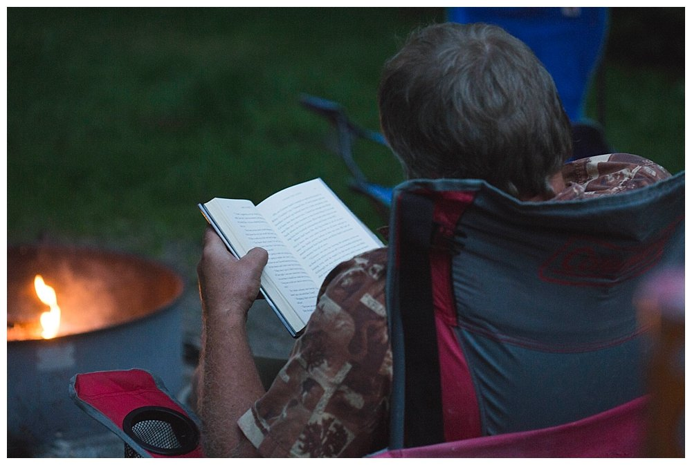 Chuck reading at the church campout.