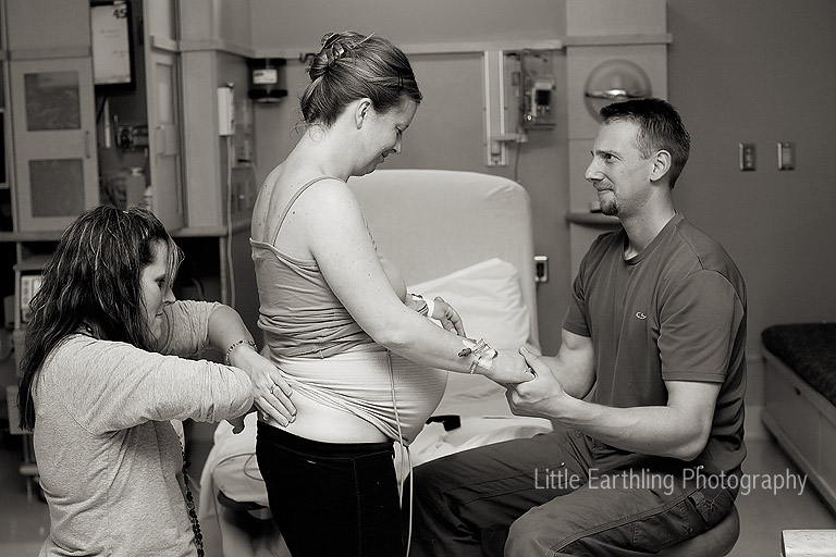 doula supporting mom during labor