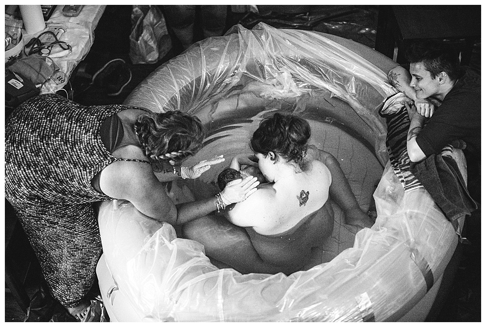 Mace was born at home in the water surrounded by love and family. Bellingham birth photographer.