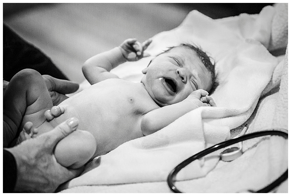 Newborn exam just after birth. Little Earthling Photography