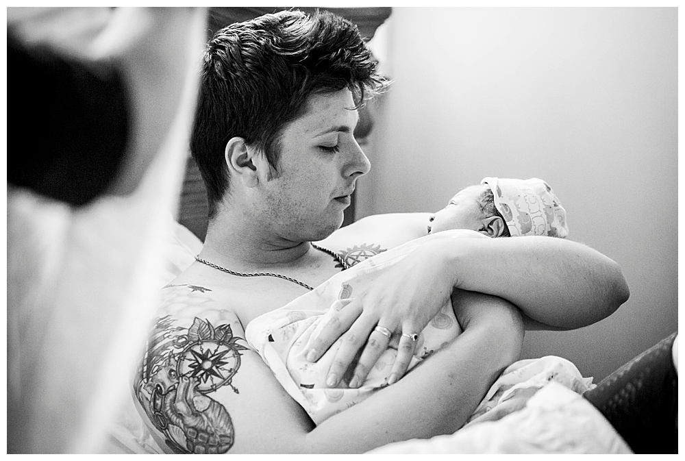 Dad having skin-to-skin with newborn baby. Little Earthling Photography.