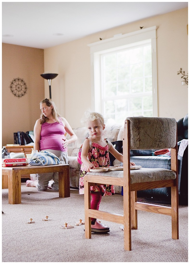 Toddler entertains herself during her mom's labor at home.