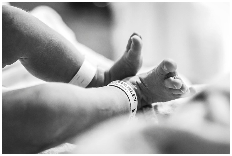 Newborn baby toes and security bands.