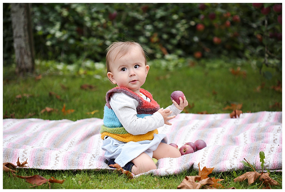 Baby playing with apple in Bellingham.