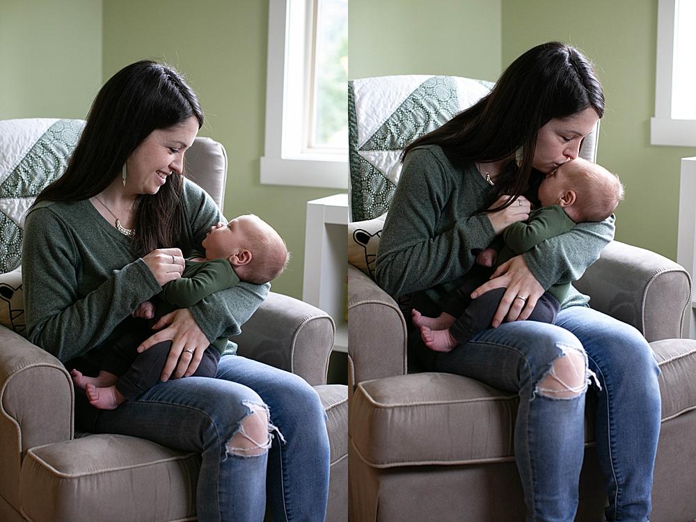 Mom kissing newborn baby. Little Earthling Photography.