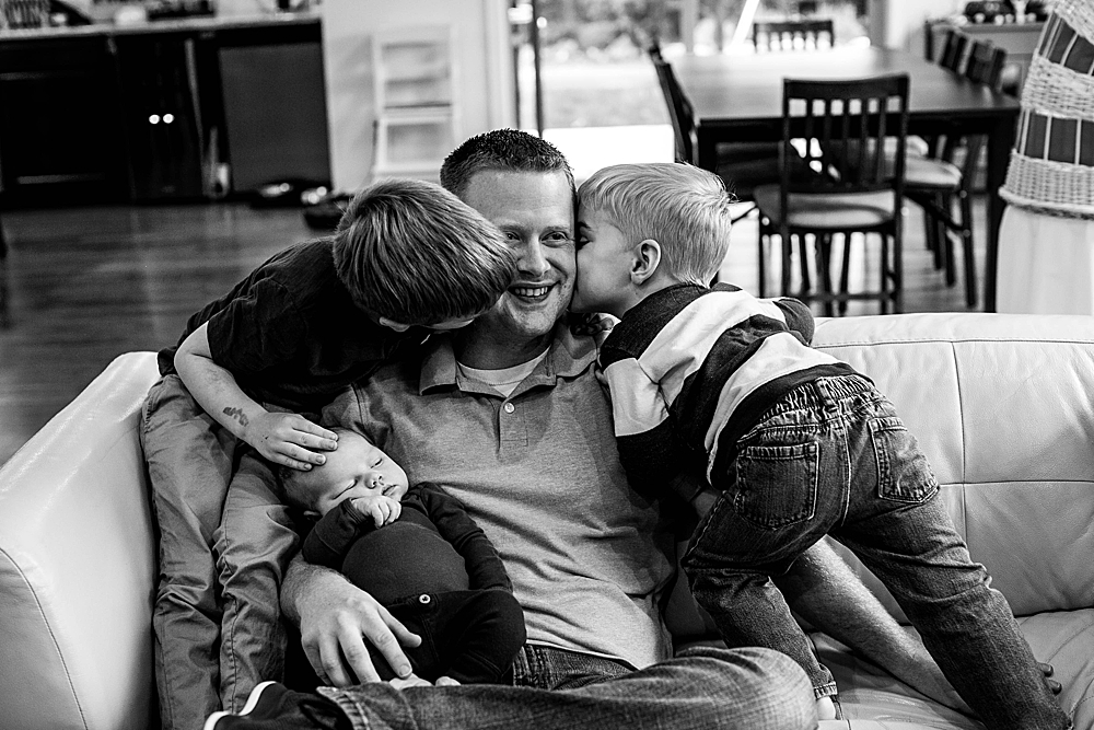 LIttle boys tackling their daddy. Bellingham family photographer.