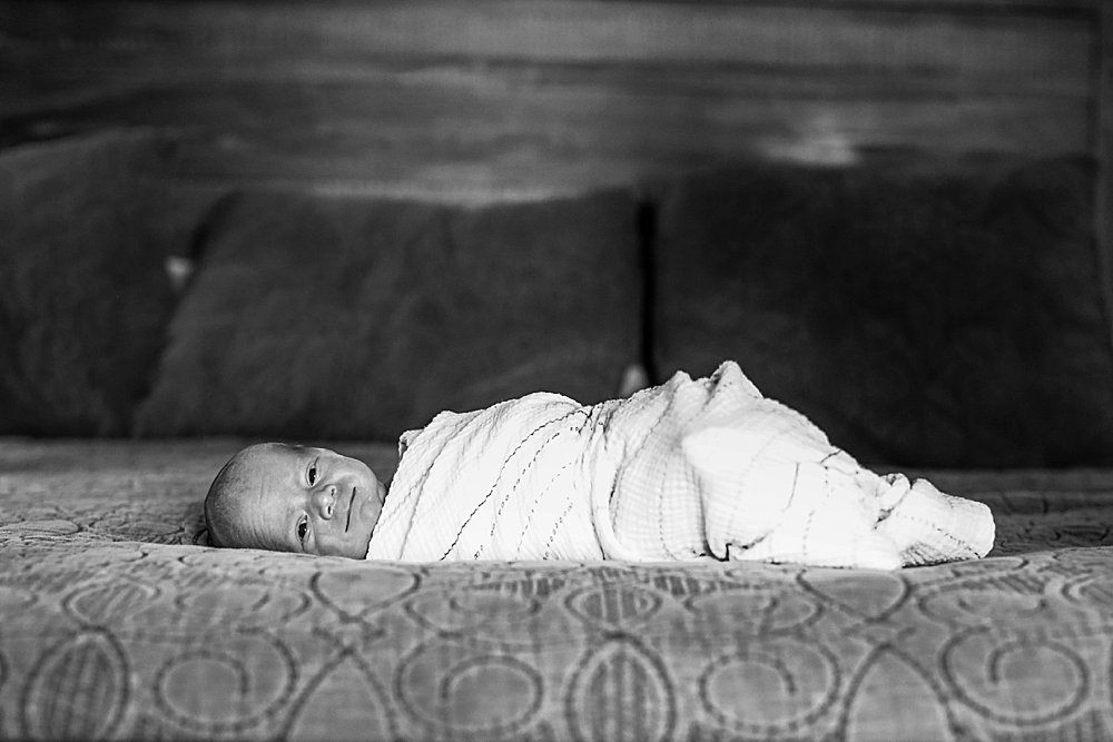Newborn baby at lifestyle photography session by Little Earthling Photography.