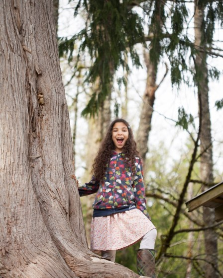 Happy girl smiling in the woods.