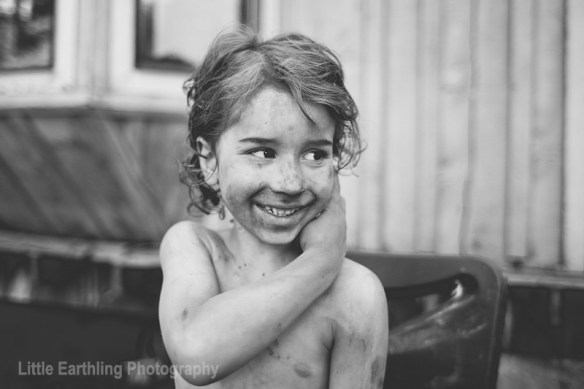 smiling boy covered in dirt